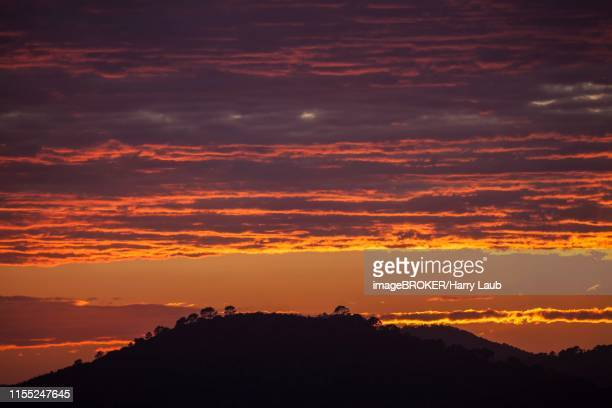 sunset, evening sky with red clouds, near paguera or peguera, majorca, balearic islands, spain - {{asset.href}} stock pictures, royalty-free photos & images