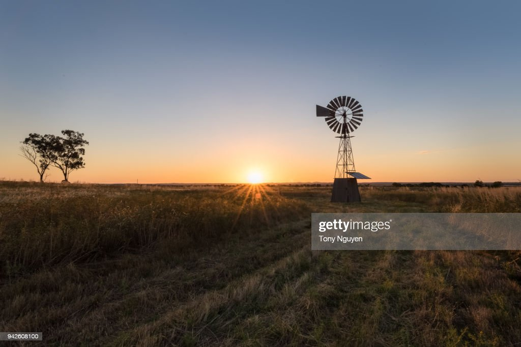 Sunset falling behind a windmill. : Stock Photo