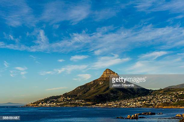 Sunset falls on Cape Town and the Lions Head overlooking Table Bay.