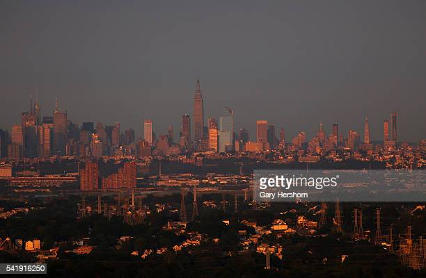 Sunset falls on homes in New Jersey and Midtown Manhattan in New York on June 18 2016 as seen from Montclair NJ