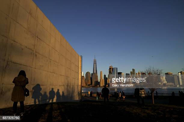 Sunset falls on lower Manhattan and One World Trade Center in New York City on January 1 2017 as seen from Liberty State Park in Jersey City NJ