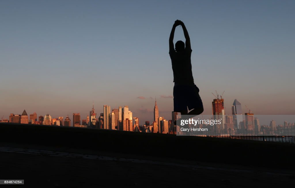 Sunset falls on lower Manhattan and the Empire State Building in New York City on August 16, 2017, as seen from Weehawken, New Jersey.