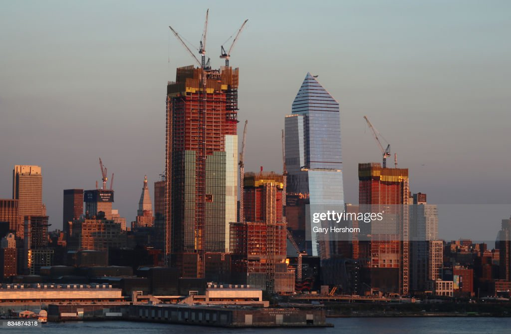 Sunset falls on midtown Manhattan and Hudson Yards in New York City on August 16, 2017, as seen from Weehawken, New Jersey.