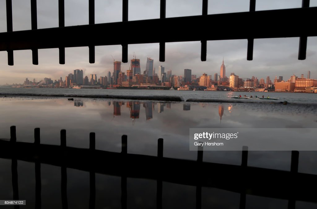 Sunset falls on midtown Manhattan and the Empire State Building in New York City on August 15, 2017, as seen from Weehawken, New Jersey.