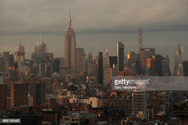 Sunset falls on the Empire State Building and midtown Manhattan on May 27 2017 in New York City