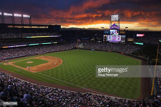 Sunset falls over the stadium as the Atlanta Braves face the Colorado Rockies at Coors Field on May 5 2012 in Denver Colorado