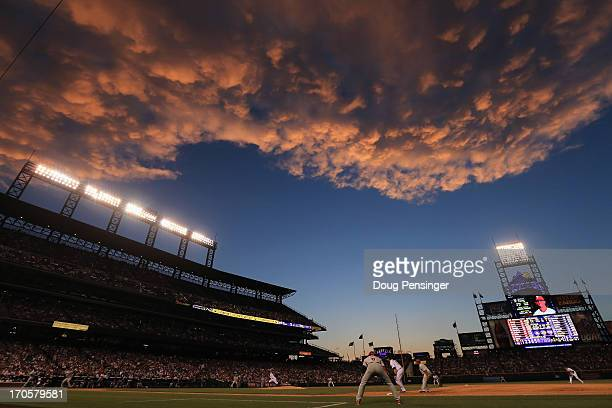 Sunset falls over the stadium as the Philadelphia Phillies face the Colorado Rockies at Coors Field on June 14 2013 in Denver Colorado