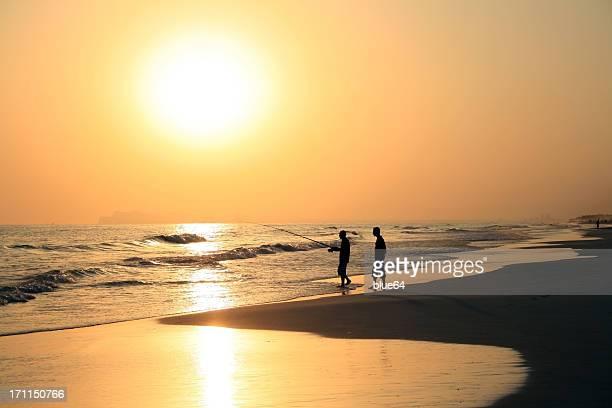 Angeln bei Sonnenuntergang, Salalah, Oman