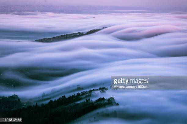 sunset fog flow - san francisco bay area stock pictures, royalty-free photos & images