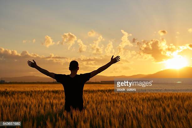 sunset, freedom and feelings - religion stock pictures, royalty-free photos & images