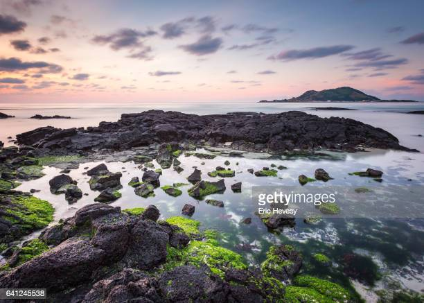 sunset from hyeopjae beach, jeju island - jeju stock photos and pictures