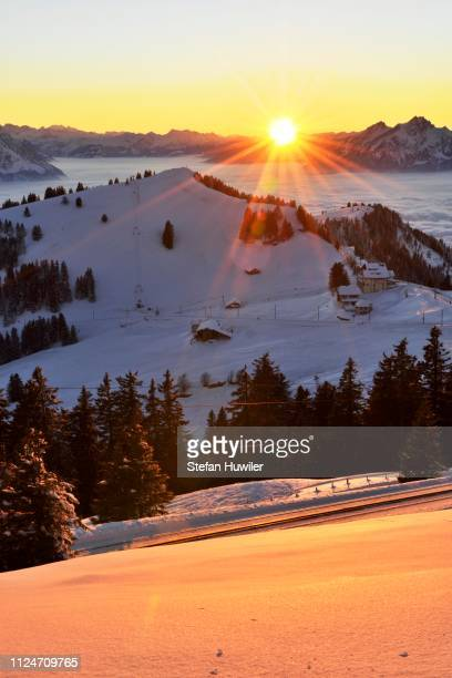 sunset from mt rigi kulm with views of the mountains rigi staffel and pilatus, canton of schwyz, switzerland - schwyz stock pictures, royalty-free photos & images