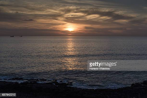 Sunset from Ponta do Sal on January 07 2017 in Cascais Portugal Ponta do Sala is favored by locals and tourists who wish to watch sunset