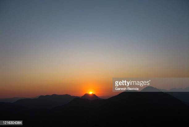 sunset from sirkot; syngja, nepal - pokhara stock pictures, royalty-free photos & images
