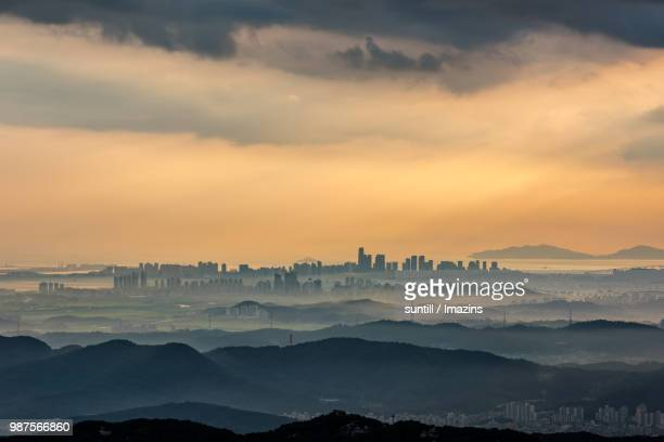sunset from songdo city, korea - songdo ibd stock pictures, royalty-free photos & images