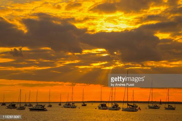 a sunset from yarmouth pier, isle of wight, united kingdom - yarmouth isle of wight stock pictures, royalty-free photos & images