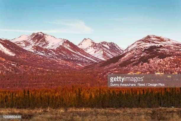 sunset glow on chugach mountains and hillside houses, viewed from anchorage, south-central alaska in springtime - chugach state park stock pictures, royalty-free photos & images