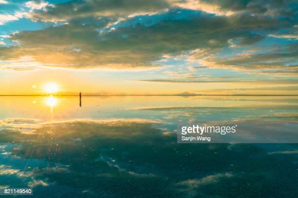 sunset glow reflection at salar de Uyuni