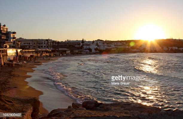 sunset, hersonissos, crete, greece - hersonissos photos et images de collection