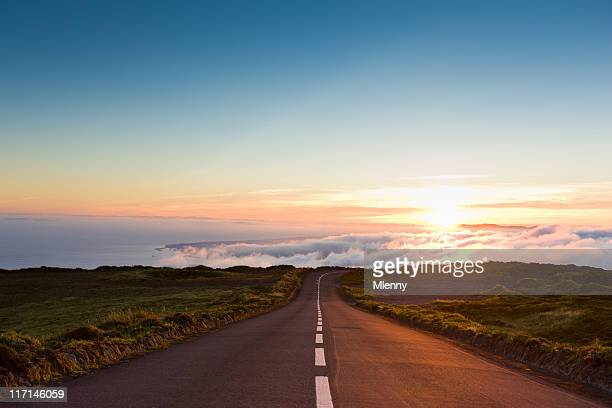 sunset highway into the clouds - horizon over land stock photos and pictures