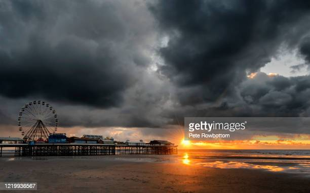 sunset in a storm - blackpool beach stock pictures, royalty-free photos & images