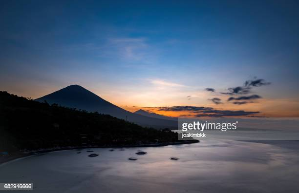 Sunset in Amed village in Bali over Agung volcano