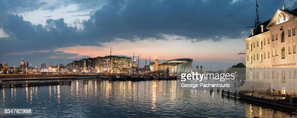 sunset in amsterdam waterfront - nemo museum stock pictures, royalty-free photos & images