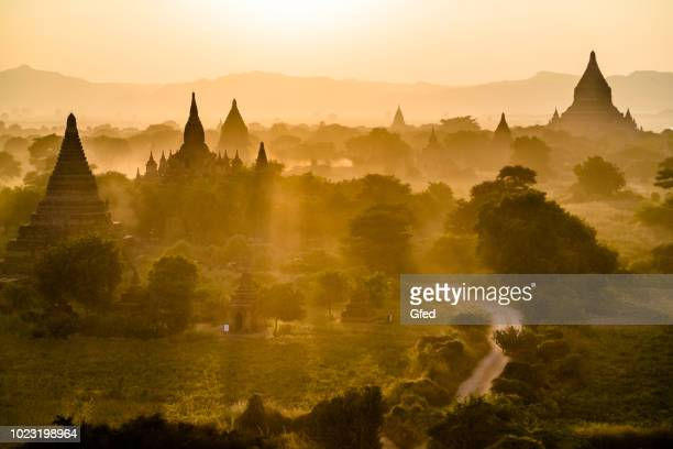 sunset in bagan - myanmar culture stock pictures, royalty-free photos & images
