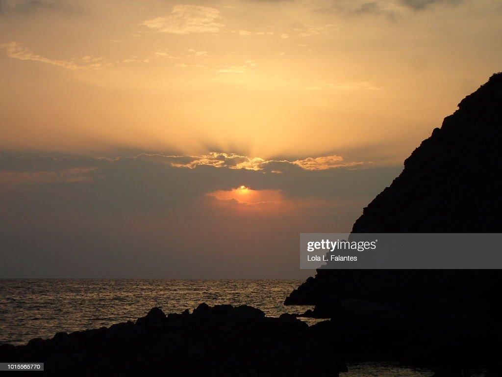 Sunset in cala Benirras, Ibiza Island, Spain : Foto de stock