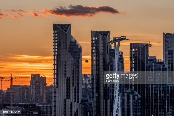sunset in canary wharf, london - the o2 england stock pictures, royalty-free photos & images