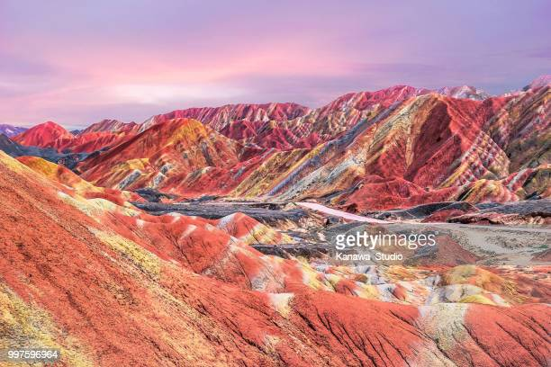 sunset in china's rainbow mountain - mountain range stock pictures, royalty-free photos & images