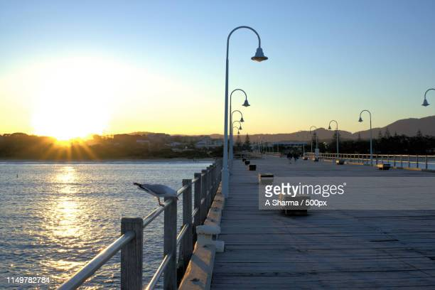 sunset in coffs harbour, australiapx - coffs harbour stock pictures, royalty-free photos & images