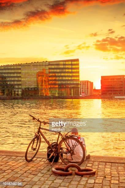 sunset in copenhagen - sentar se imagens e fotografias de stock