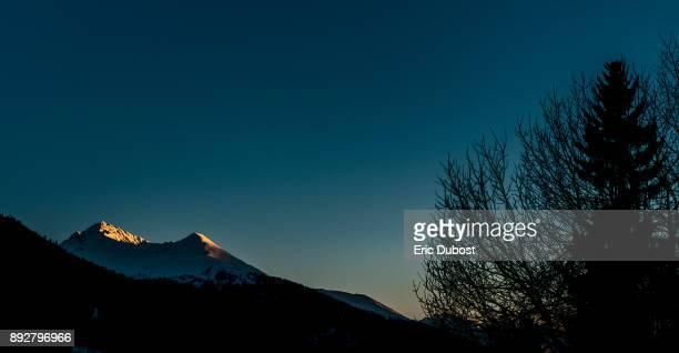 sunset in davos - davos stock-fotos und bilder