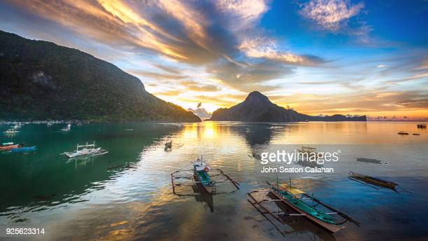 sunset in el nido - palawan stock pictures, royalty-free photos & images