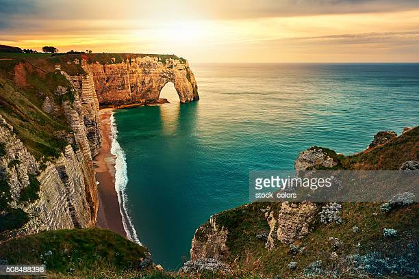 sunset in etretat - france stock pictures, royalty-free photos & images