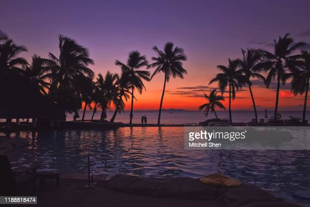 sunset in fiji - fiji stock pictures, royalty-free photos & images