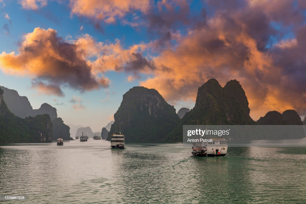 Sunset in Halong Bay, Vietnam. View of cruise ships and islands in Halong Bay, Vietnam : Stock Photo