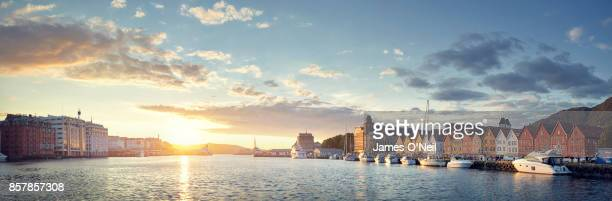 sunset in harbor panoramic, bergen, norway - bergen norway stock pictures, royalty-free photos & images