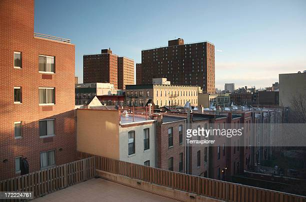 sunset in harlem - harlem stock pictures, royalty-free photos & images