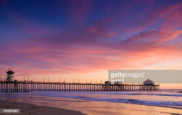 sunset in huntington beach - huntington beach stock pictures, royalty-free photos & images