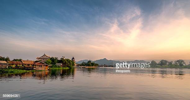 sunset in kanchanaburi - lifeispixels stock pictures, royalty-free photos & images