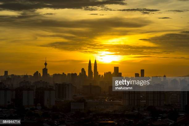 sunset in klcc - shaifulzamri stock pictures, royalty-free photos & images