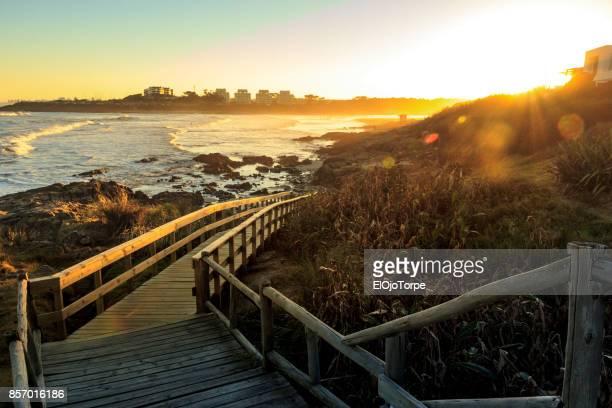 """sunset in """"la barra"""" beach, punta del este, uruguay - maldonado uruguay stock pictures, royalty-free photos & images"""