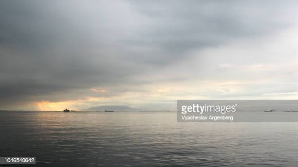 sunset in manila bay, a sight to behold, heavy overcast sky, philippines - argenberg stock pictures, royalty-free photos & images
