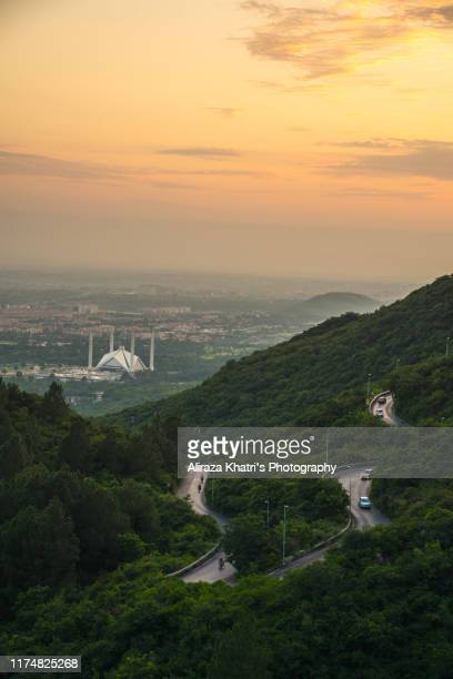sunset in margalla hills, islamabad - islamabad stock pictures, royalty-free photos & images