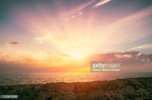 sunset in menorca, spain - 年次イベント ストックフォトと画像