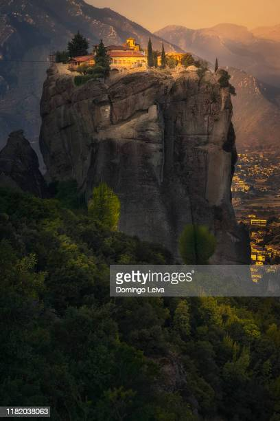 sunset in meteora, greece - meteora stock pictures, royalty-free photos & images