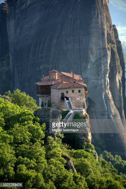 sunset in meteora valley - meteora stock pictures, royalty-free photos & images