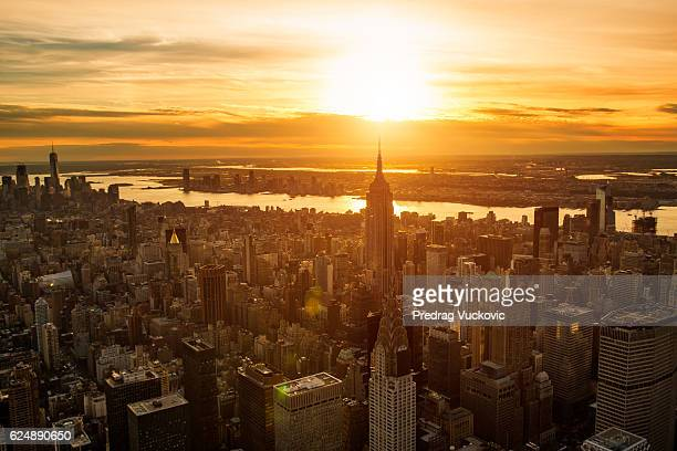 sunset in new york - queens new york city stock pictures, royalty-free photos & images